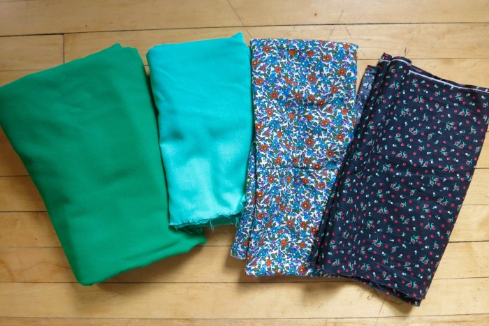 Various thrifted fabrics. The green on the left is a lovely wool suiting (squee!)
