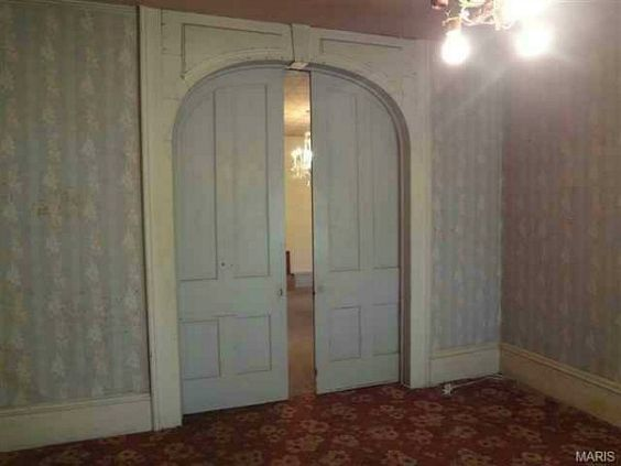 one of the few examples I could find online of this style of door. Maybe ours looked something like this?