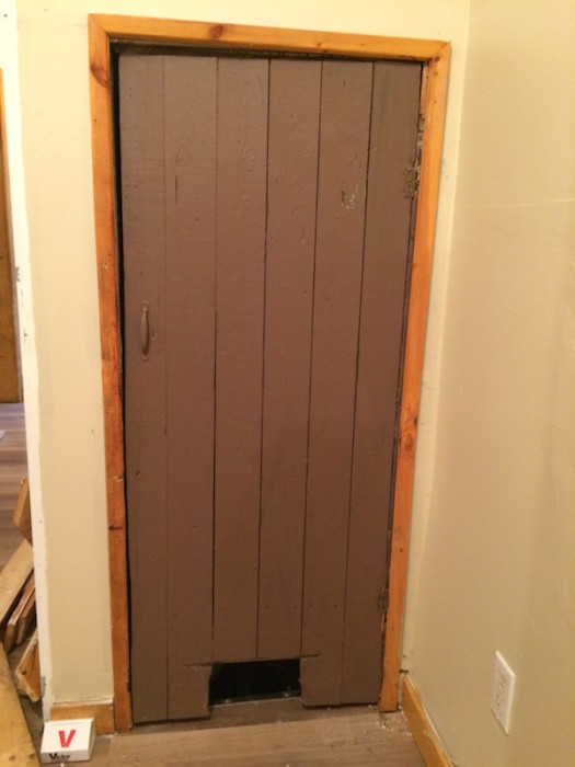Basement door made of old floorboards.